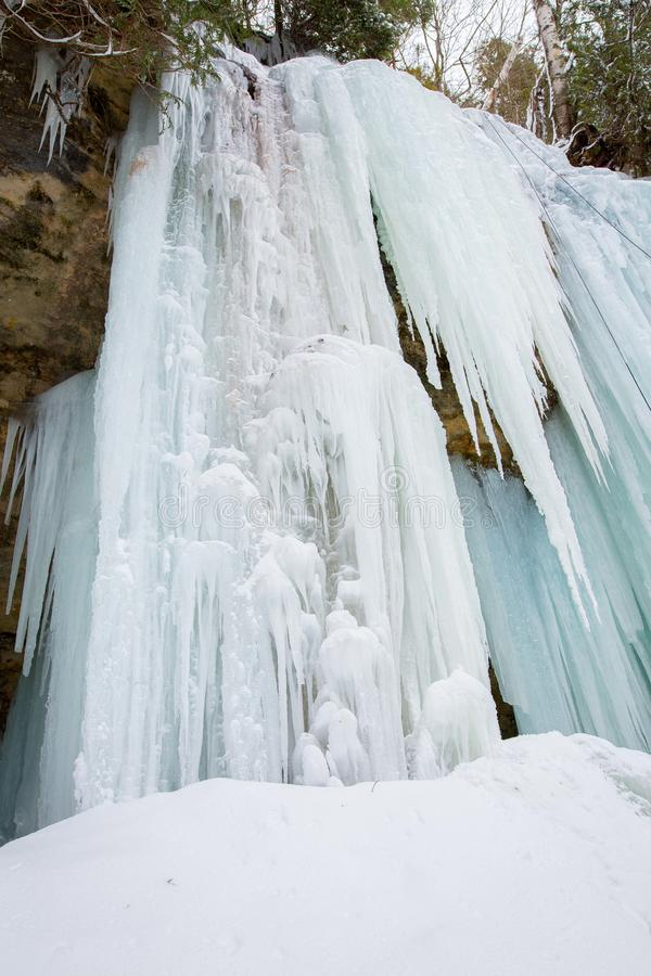 Ice formation, Munising, Michigan, pictured rocks national lakeshore. Ice formation and sandstone cliff on the North Country Trail near Sand Point in the royalty free stock images