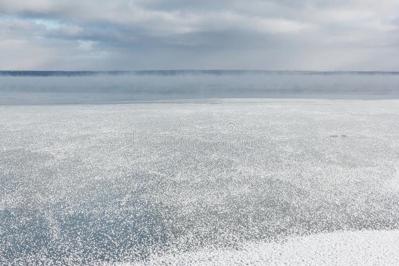 Ice forming on the river , Ob reservoir, Siberia, Russia royalty free stock images