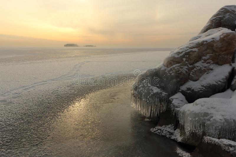 Ice forming on the river in autumn at sunset royalty free stock image