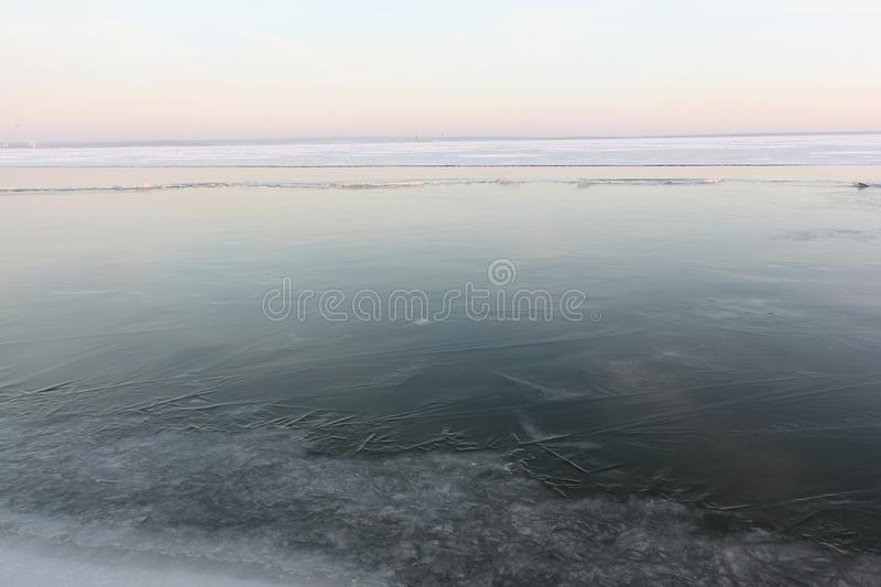 Ice forming on the river in autumn at sunset , Ob reservoir, Siberia stock photo