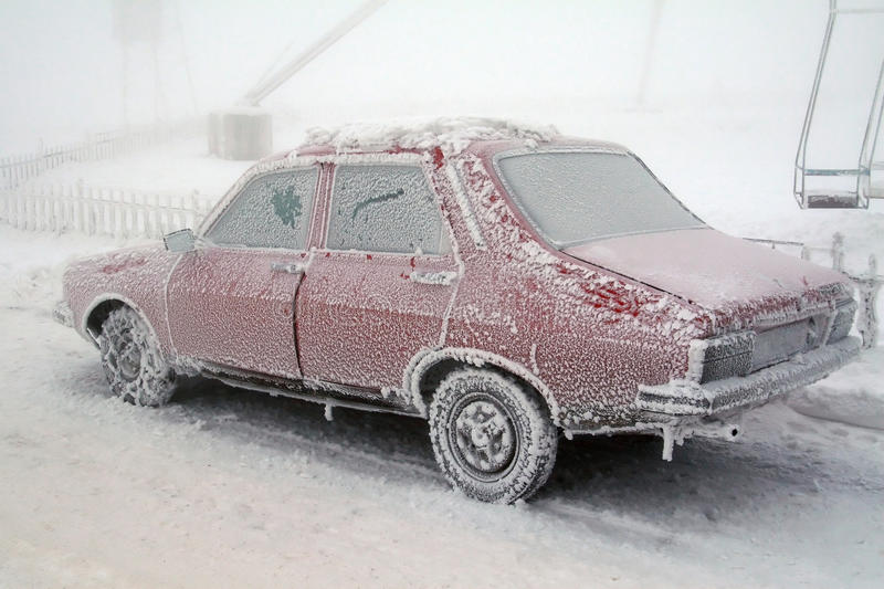 Ice frost on frozen car in winter stock images