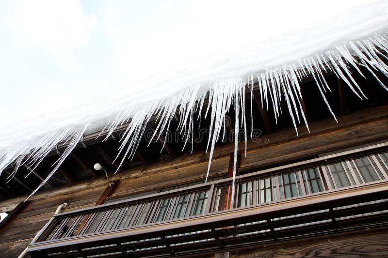 Ice frozen on the house roof stock photography