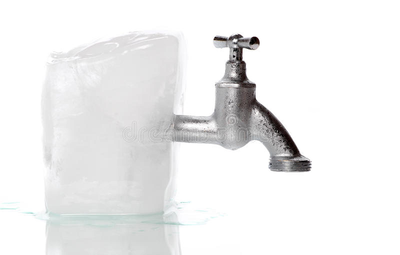 Ice with frozen water-tap. On white background royalty free stock photos