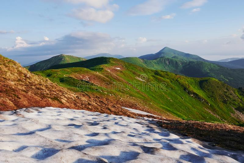 Ice on the grass. Majestic Carpathian mountains. Beautiful landscape. Breathtaking view stock photo