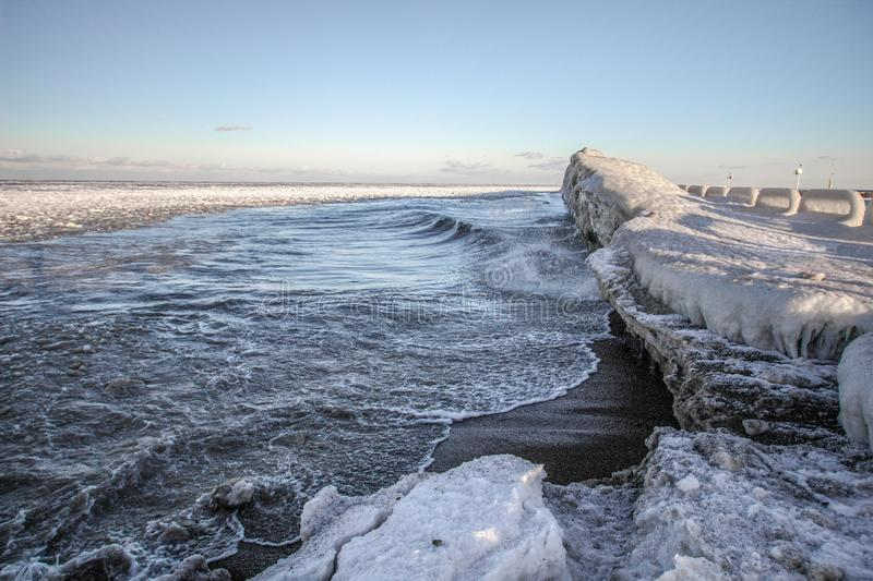 Ice On The Great Lakes Coast. Ice On The Great Lakes. Ice on the frozen Great Lakes as waves splash on the coast on a cold winter morning. Port Sanilac, Michigan royalty free stock images