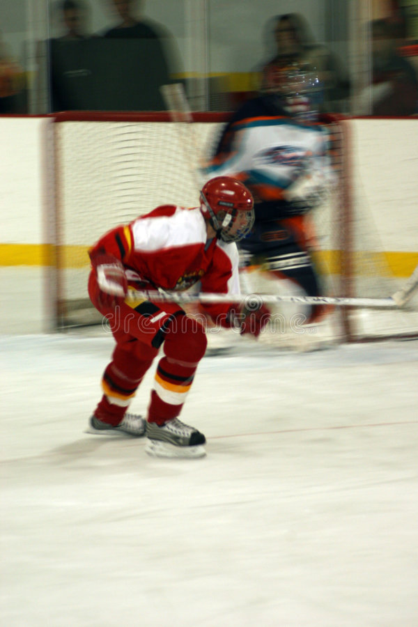 Ice Hockey Blur. Blurred action shot of a youth Ice Hocky player royalty free stock photos