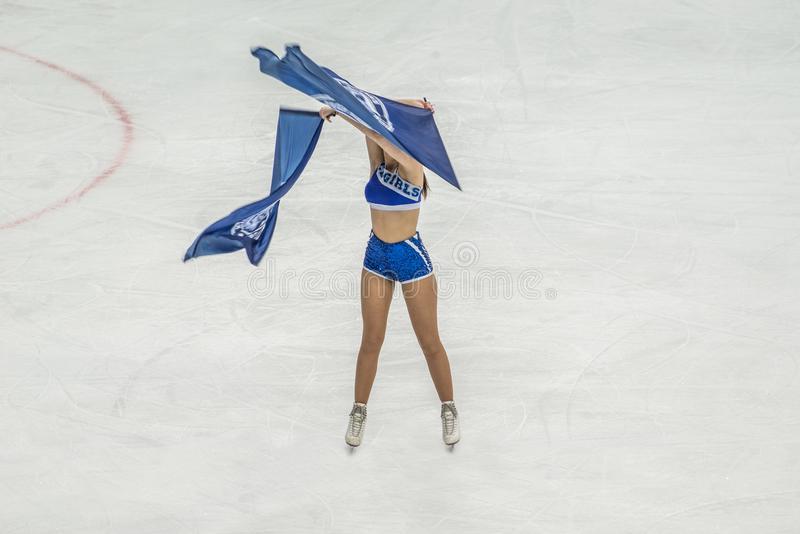 Ice hockey cheerleader with flags royalty free stock photo
