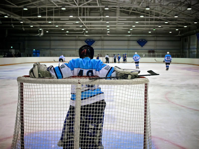 Ice Hockey Game. Goalkeeper hockey player standing at the gate stock photos