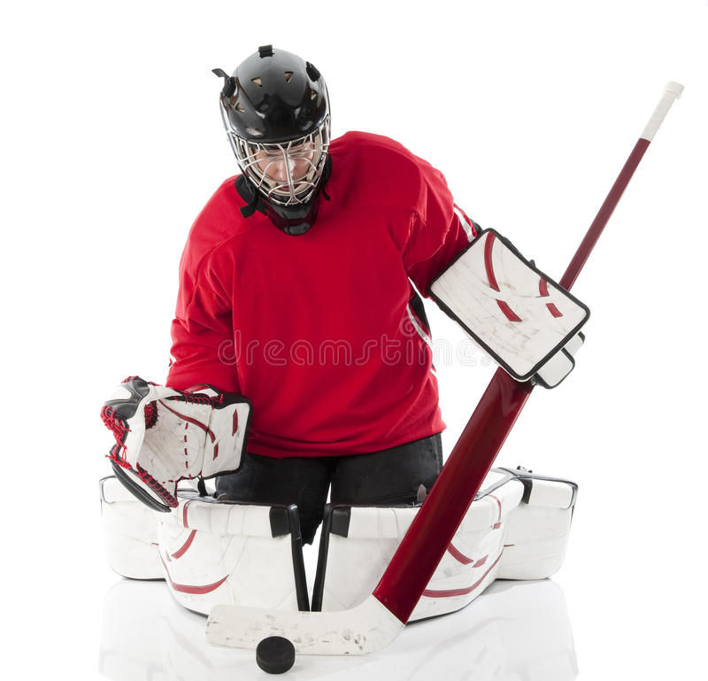 Ice hockey goalie. Blocking a puck in butterfly style. Photo on white background stock photo