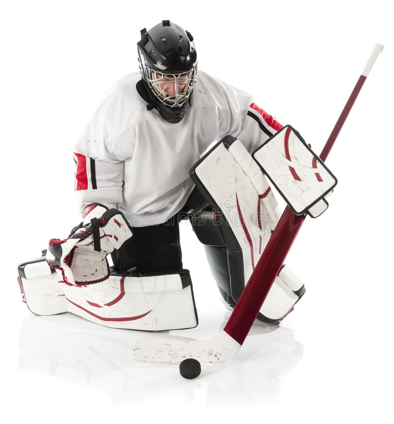 Ice hockey goalie. Blocking a puck with stick. Photo on white background stock image