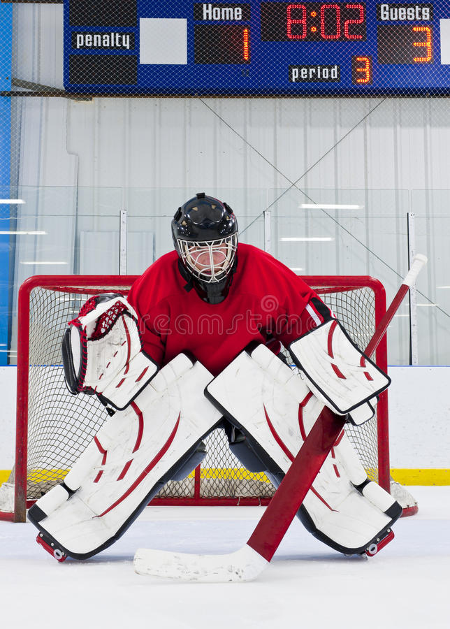 Ice hockey goalie. In front of his net. Picture taken in ice arena stock image