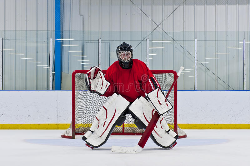 Ice hockey goalie. In front of his net. Picture taken in arena stock image