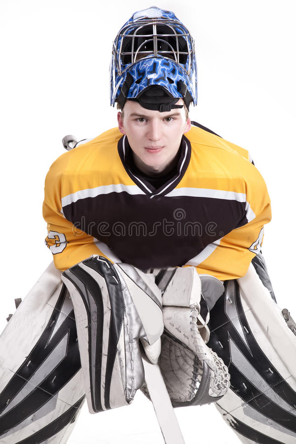 Ice hockey goalie. Blocking a puck with stick. Photo on white background royalty free stock images