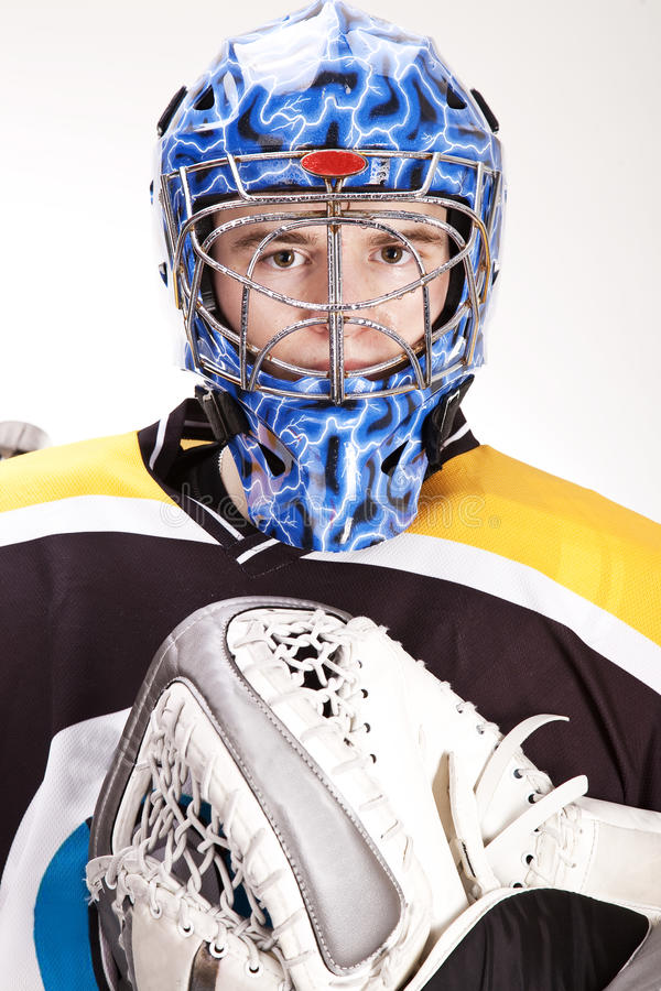 Ice hockey goalie. Blocking a puck with stick. Photo on white background stock images
