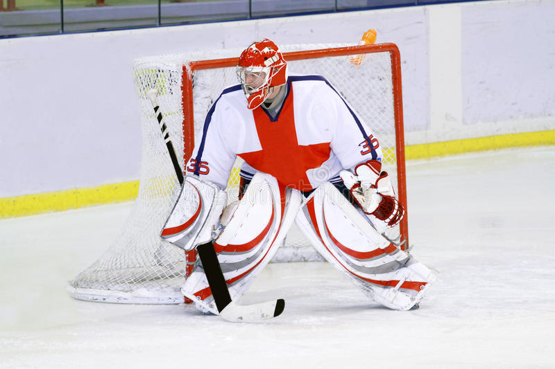 Ice hockey goalie. In front of his net. Picture taken on ice rink arena stock photography