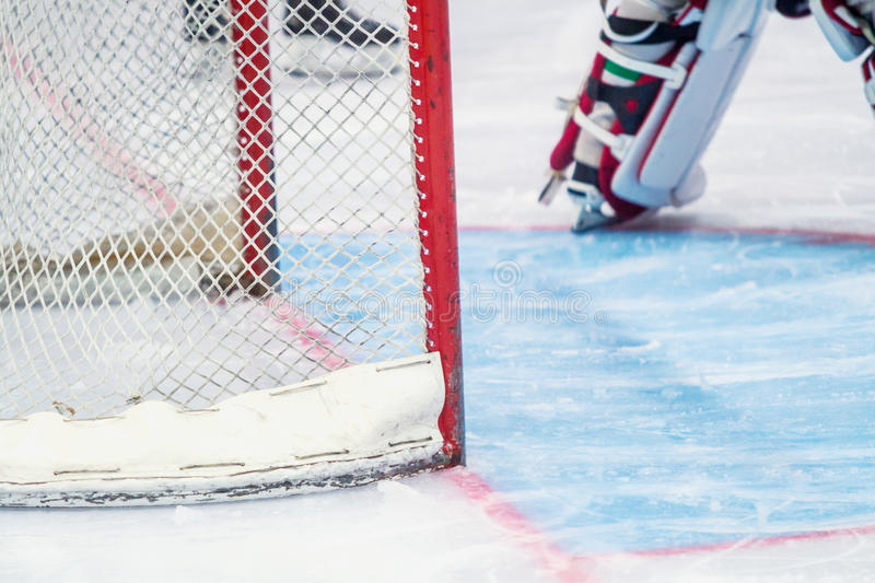 Ice hockey goalie during a game. An ice hockey goalie during a game stock photo