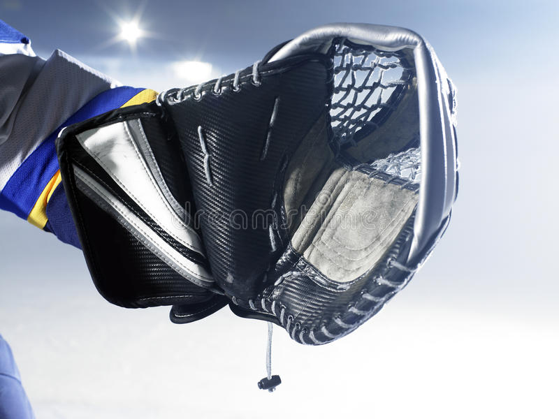 Ice hockey goalie glove. Ready to save royalty free stock images