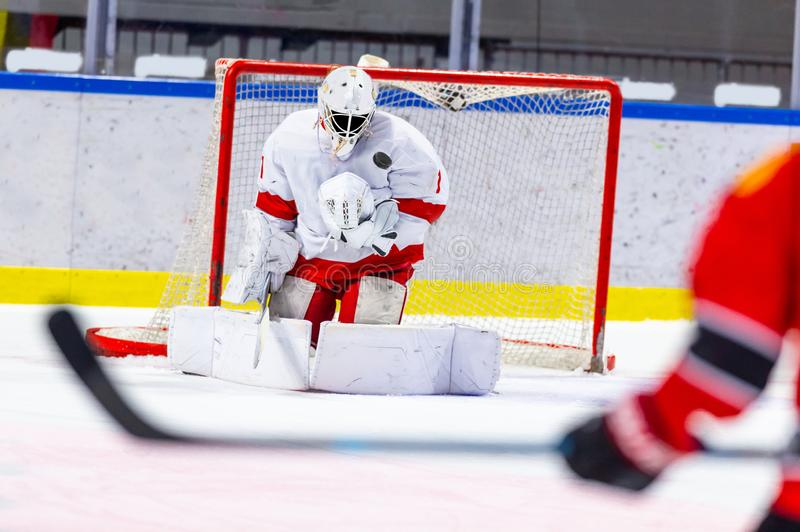 Ice hockey goalie makes a great save. No goal stock photos