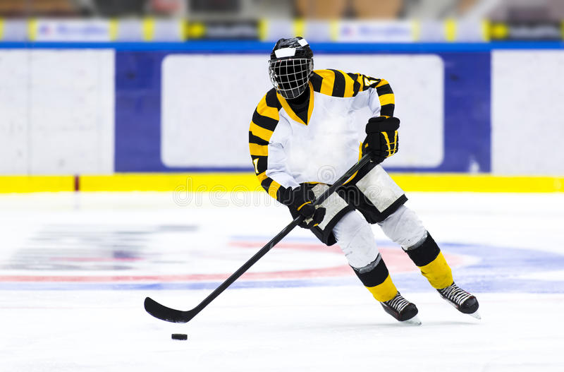 Ice hockey player. With the puck royalty free stock photos