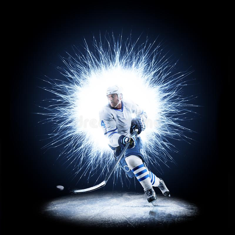 Ice Hockey player is skating on a abstract background. With intensional light stock images