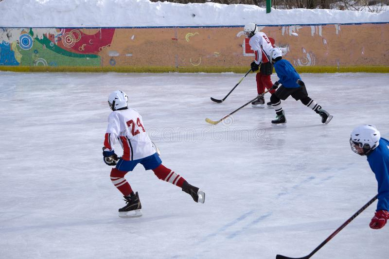 Ice hockey players on the ice . stock photo