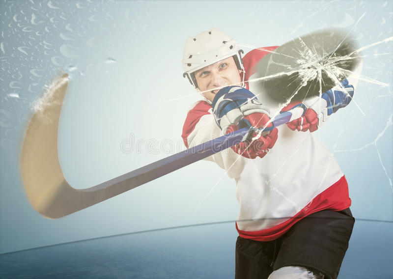 Ice hockey puck hit the opponent visor royalty free stock photography