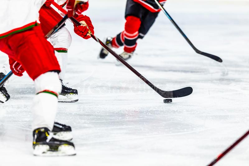 Ice hockey sport indoor stadium game. Puck stock image