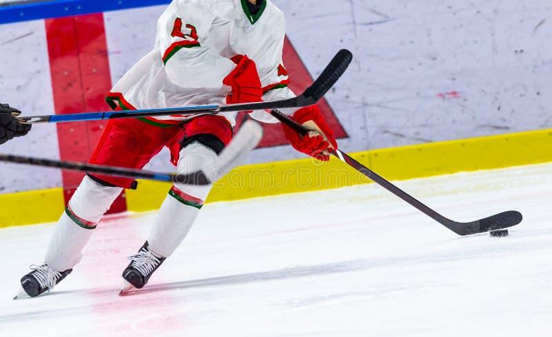 Ice hockey sport indoor stadium game. Puck stock photography