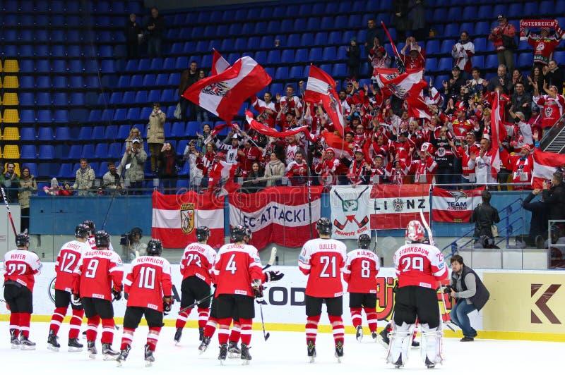 Ice Hockey 2017 World Championship Div 1 in Kyiv, Ukraine. KYIV, UKRAINE - APRIL 24, 2017: Austrian fans show their support during IIHF 2017 Ice Hockey World stock photos
