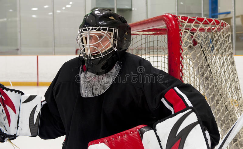 Ice hocley goalie. Ice hockey goalie protecting his net stock photo