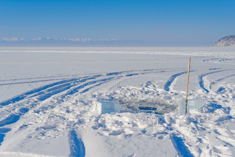 Ice hole. On the baikal lake stock photos