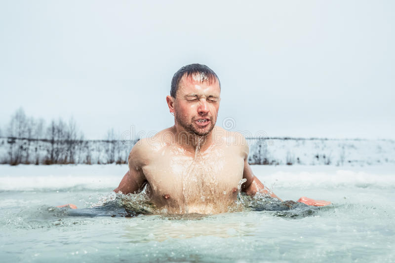 Ice hole swimming stock image