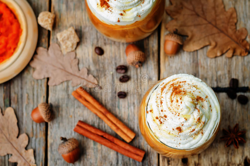 Ice honey pumpkin spice latte with whipped cream. The toning. selective focus stock images