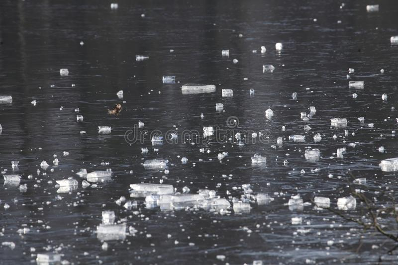 Ice on an icebound lake. Ice cover on an icebound lake royalty free stock images