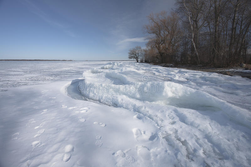 Ice on the lake. In the evening royalty free stock photography