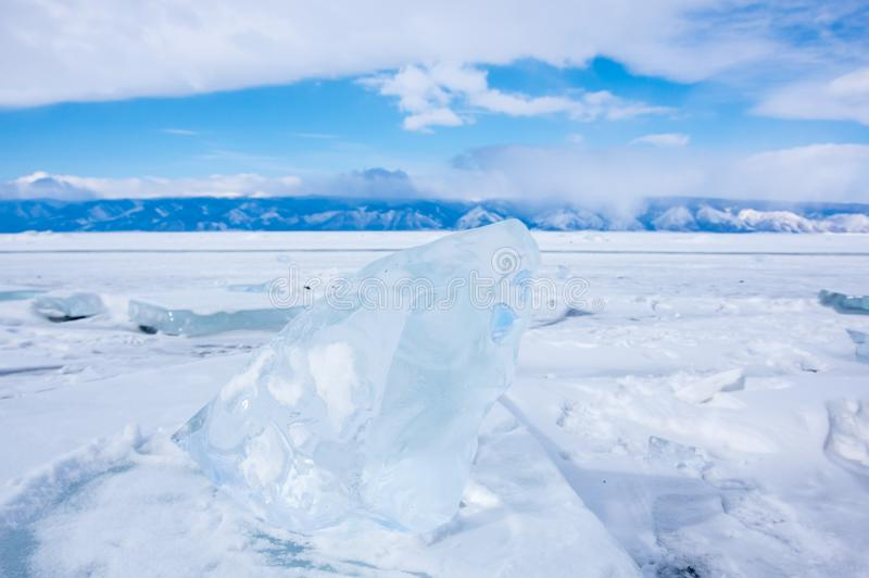 Ice of Lake Baikal. The deepest and largest freshwater lake by volume in the world, located in southern Siberia, Russia royalty free stock photography