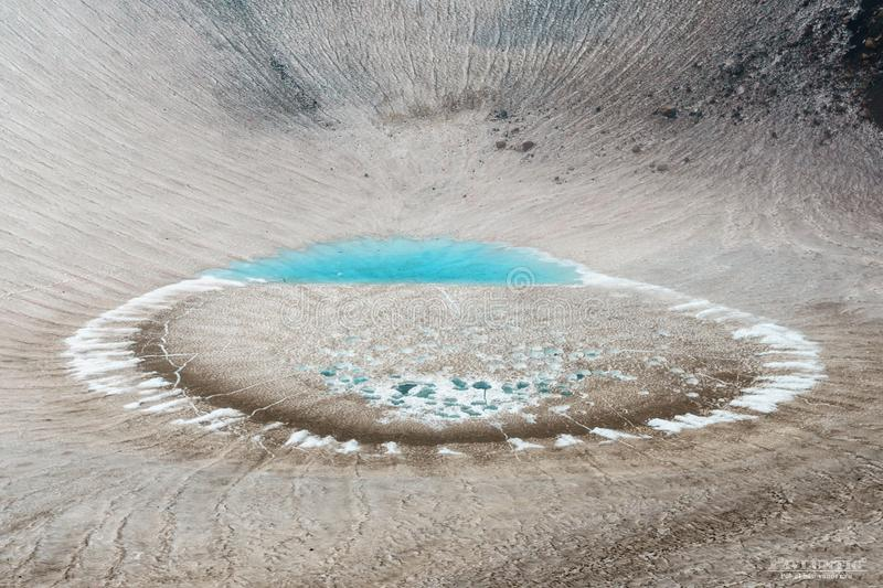Ice lake in the crater of Gorely volcano, Kamchatka, Russia stock image