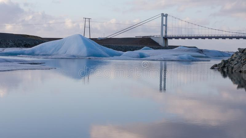 Ice lake with suspension bridge in royalty free stock photography