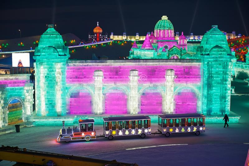The ice-lantern festival and little train nighscape. The photo was taken in Harbin Ice & Snow World Harbin city Heilongjiang province, China royalty free stock image