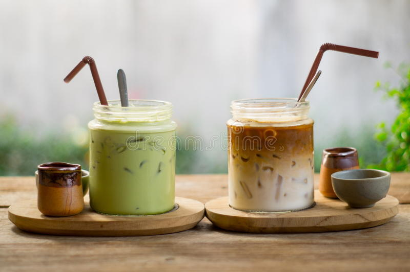 Ice latte coffee and matcha green tea. On wood table stock photos