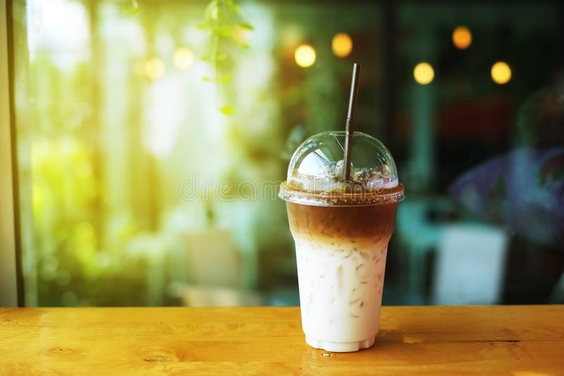 Ice latte coffee. In plastic cup with copyspace and background stock photography