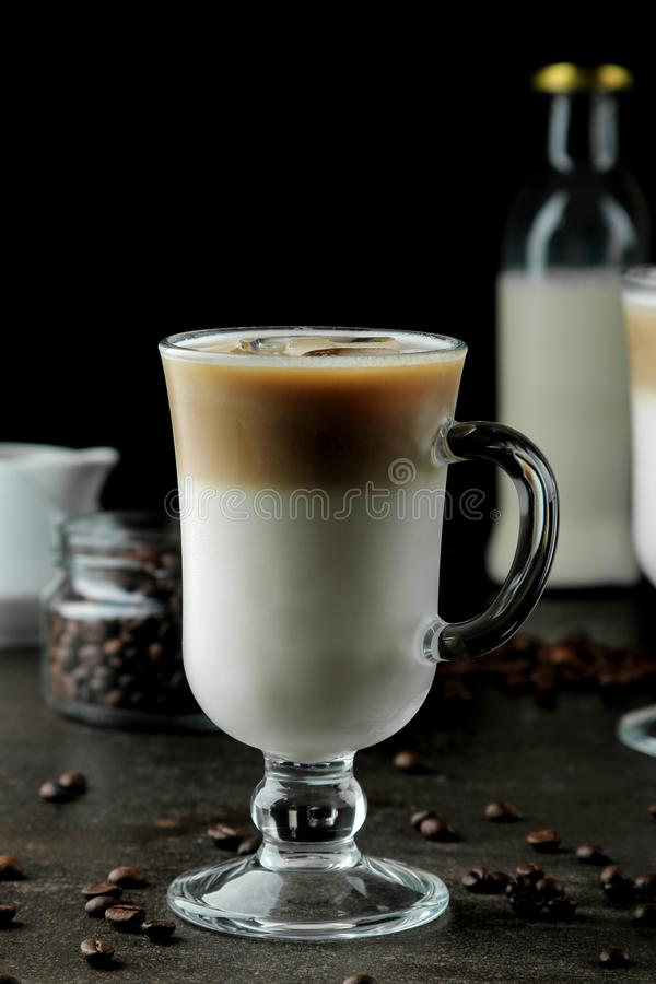 Ice latte or Iced coffee with milk and ice cubes in a glass beaker against a dark background. refreshing drink. summer drink. Ice latte or Iced coffee with milk royalty free stock image