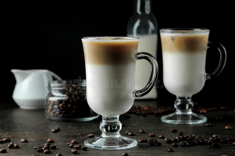 Ice latte or Iced coffee with milk and ice cubes in a glass beaker against a dark background. refreshing drink. summer drink. Ice latte or Iced coffee with milk stock photography