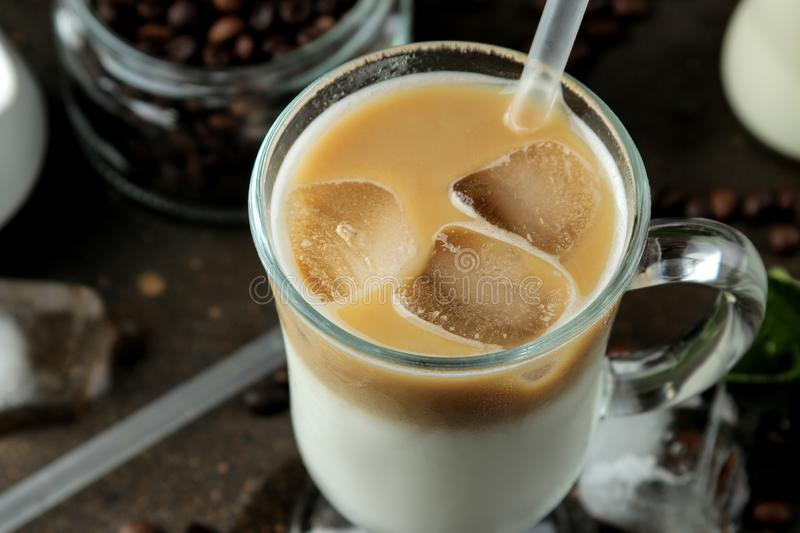 Ice latte or Iced coffee with milk and ice cubes in a glass beaker against a dark background. refreshing drink. summer drink. Ice latte or Iced coffee with milk stock photos