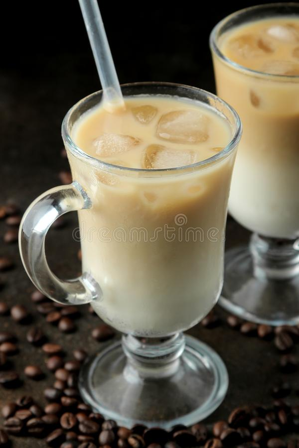 Ice latte or Iced coffee with milk and ice cubes in a glass beaker against a dark background. refreshing drink. summer drink. Ice latte or Iced coffee with milk royalty free stock photo