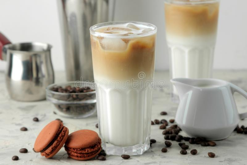 Ice latte or Iced coffee with milk and ice cubes in a glass beaker on a light background. refreshing drink. summer drink. Ice latte or Iced coffee with milk and stock images