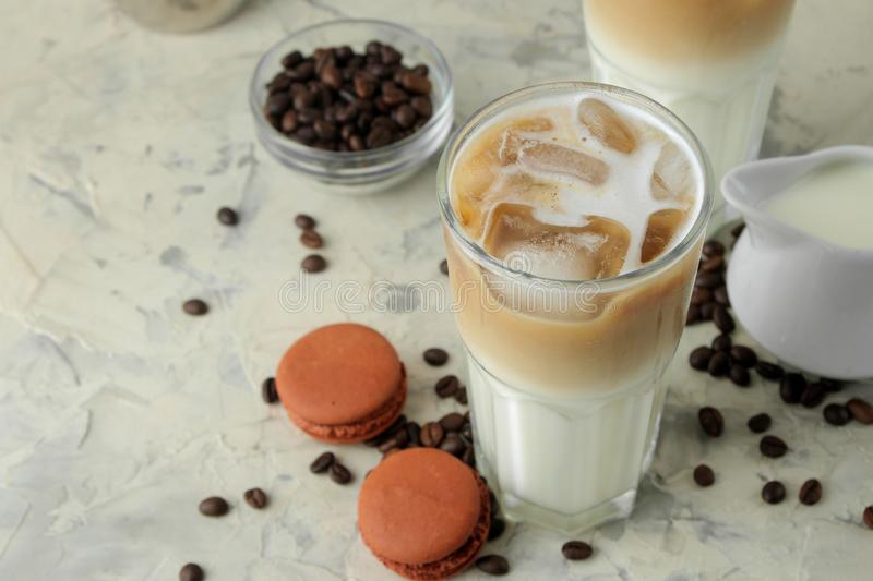 Ice latte or Iced coffee with milk and ice cubes in a glass beaker on a light background. refreshing drink. summer drink. Ice latte or Iced coffee with milk and royalty free stock photo