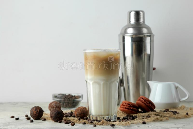 Ice latte or Iced coffee with milk and ice cubes in a glass beaker on a light background. refreshing drink. summer drink. Ice latte or Iced coffee with milk and stock photo
