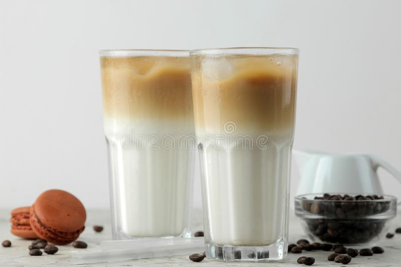Ice latte or Iced coffee with milk and ice cubes in a glass beaker on a light background. refreshing drink. summer drink. Ice latte or Iced coffee with milk and royalty free stock photography