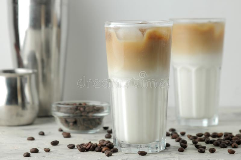 Ice latte or Iced coffee with milk and ice cubes in a glass beaker on a light background. refreshing drink. summer drink royalty free stock photography